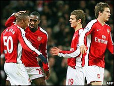 Arsenal celebrate Simpson's first goal against Wigan