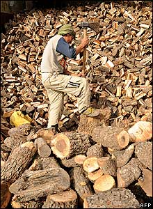 An Afghan labourer splits firewood in Kabul