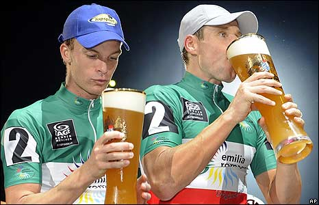 German cyclists Robert Bartko (R) and his teammate Iljo Keisse celebrate in the Olympic hall in Munich, southern Germany