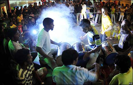 Maldivian Democratic Party supporters celebrate the victory of their presidential candidate Mohamed Nasheed in Male