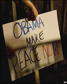 Signs in Israel calling for Barack Obama to 'make peace'