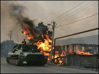 Russian tank next to a house set on fire by South Ossetian militia on August 18
