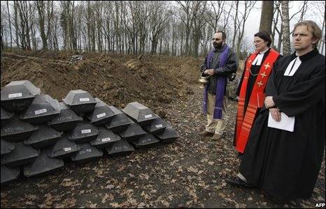 Priests at a ceremony to bury German remains in a Czech cemetary.