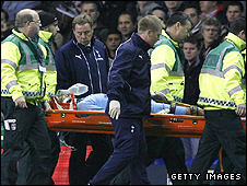Heurelho Gomes is stretchered off the field