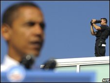 Security agent overlooking Barack Obama