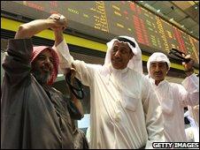Traders celebrate the halt in trading
