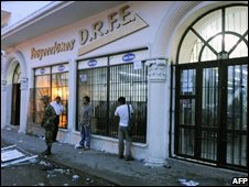 Police stand guard outside the offices of the DRFE company in Popoyan