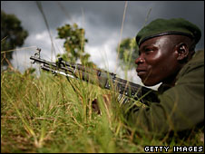 A Congolese army soldier on the ground at the frontline in the east