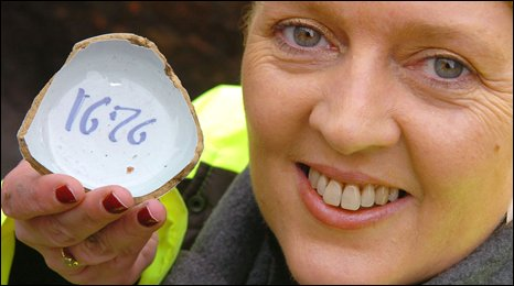 Archaeologist Audrey Gahan holds the bowl fragment discovered in Belfast city centre