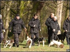 Police officers and dogs during the search for Shannon