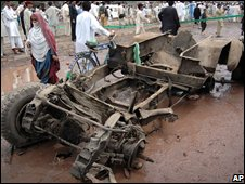 The wreckage of a truck destroyed by an explosion near Peshawar