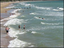 Surfers and swimmers at Boscombe beach