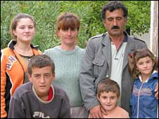 Nicolin (first left in the front row) and his family