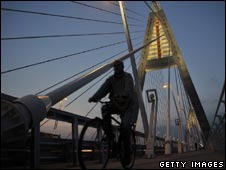 Man cycling over Megyeri Bridge