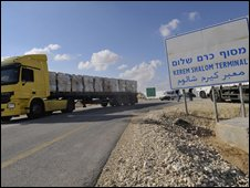Aid lorries leave the Kerem Shalom crossing after being denied entrance to the Gaza Strip by Israeli authorities, 13 November 2008
