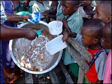 Children wait for food at the Tumaini Timwani School in Kenya