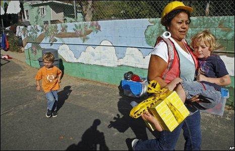 Schoolteacher carries child