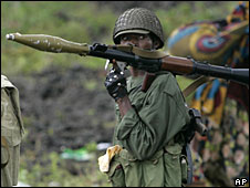 A Congolese army soldier carrying a weapon