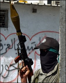 A Palestinian militant from Hamas holds a rocket propelled grenade launcher