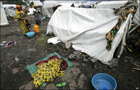 A child sleeps in a camp near Goma