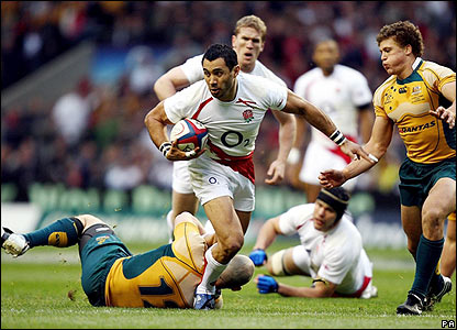 England's inside centre Riki Flutey makes a break