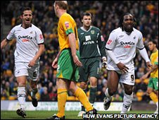 Swansea scorers Ferrie Bodde and Jason Scotland celebrate at Norwich