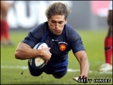 Hooker Dimitri Szarzewski runs in a try for France