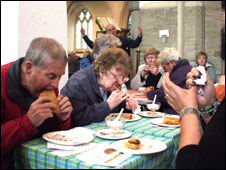 Hungry trippers tuck in to their pasties
