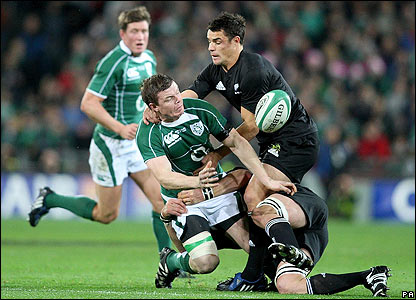 Ireland skipper Brian O'Driscoll attempts to offload the ball