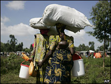 Two displaced mothers and children at a camp near Goma, 15 Nov