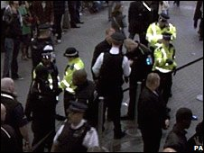 Police in the aftermath of the stabbing at the O2