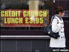 A woman looks at credit crunch lunch sign outside a pub in Edinburgh.
