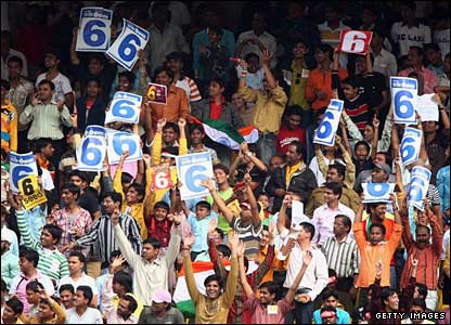 The crowd go wild at the Nehru Stadium