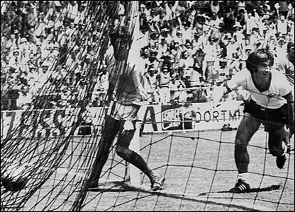 Gerd Muller wheels away in celebration after scoring for West Germany