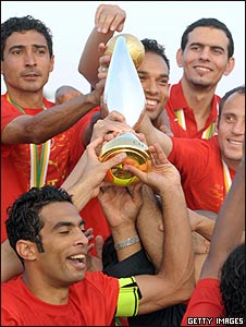 Al Ahly players celebrate with the Champions League trophy