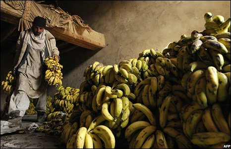 A man carries bananas at a market in Kabul, Afghanistan