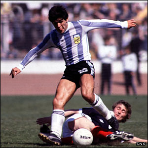 Diego Maradona skips past the challenge of Scotland's Paul Hegarty