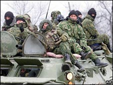 Russian troops ride into Chechnya on an armoured carrier in January 2000