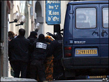 Police lead Mr Garikoitz Aspiazu, under a blanket, to a van on 17 November 2008