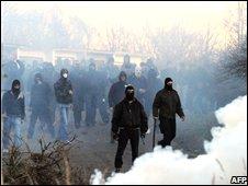 Rioters approach police in Litvinov on 17 November