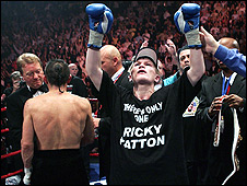 Ricky Hatton is victorious against Kostya Tszyu (far left)