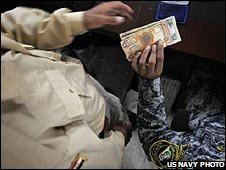 Sahwa member receives money from Iraqi military paymaster