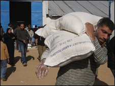 Palestinian man carrying UN aid