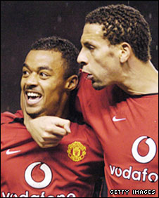 Rio Ferdinand congratulates David Bellion after his goal against Everton in December 2003