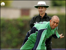 Andre Botha in action for Ireland, watched by umpire Billy Bowden