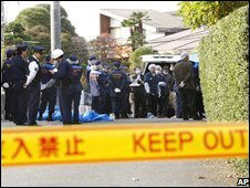 Police at a house where a former health ministry official and his wife were found dead, in Saitama, Japan, 18 November 2008