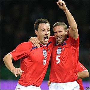 England captain John Terry congratulates Matthew Upson