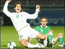 Szabolcs Huszti of Hungary is brought down by David Healy