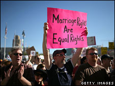 A man holds a placard at a protest in San Francisco on 15 November against the gay marriage ban