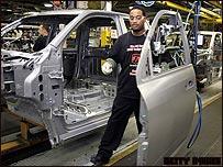Trabajadores en fábrica de Chrysler